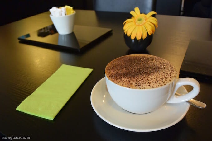 Coffee and flowers on table