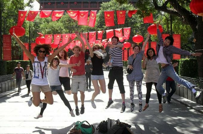 Jumping photos with friends under Chinese flags in Xi'an