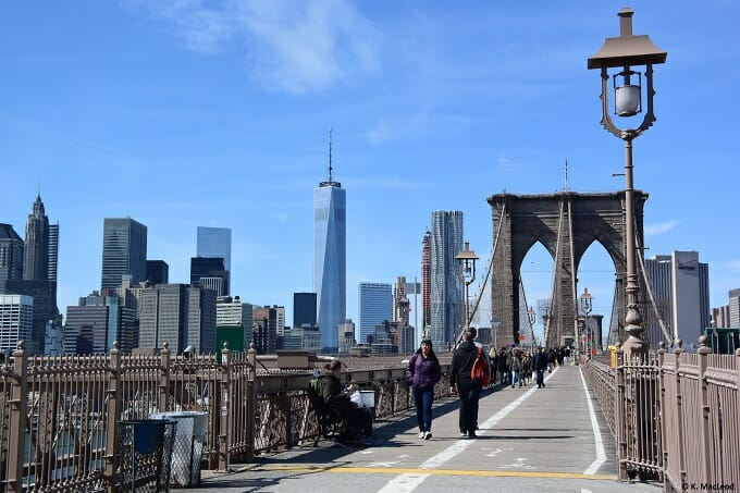 People cross the Brooklyn Bridge, New York City