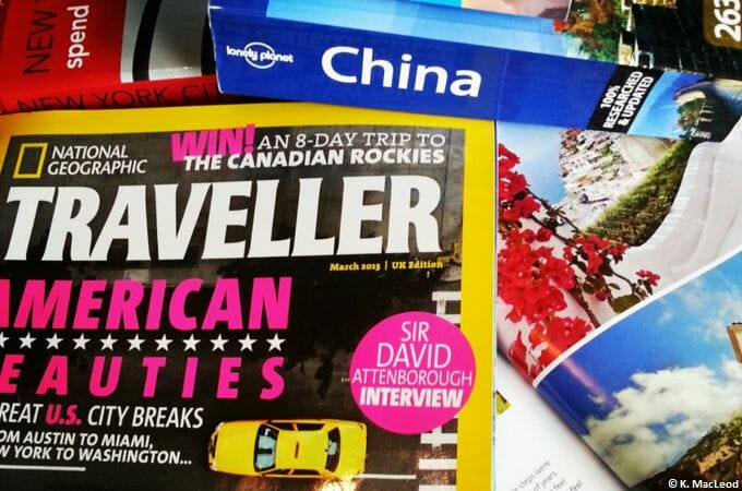 Travel magazines and guides on a table
