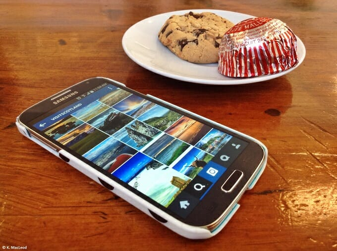 A smart phone and Tunnocks tea cake on a table