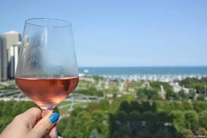 A glass of wine and a view of Lake Michigan