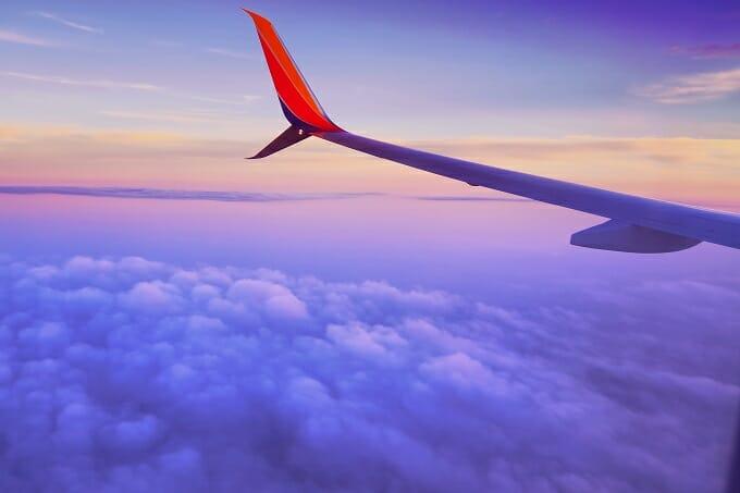 Plane wings inspiring wanderlust