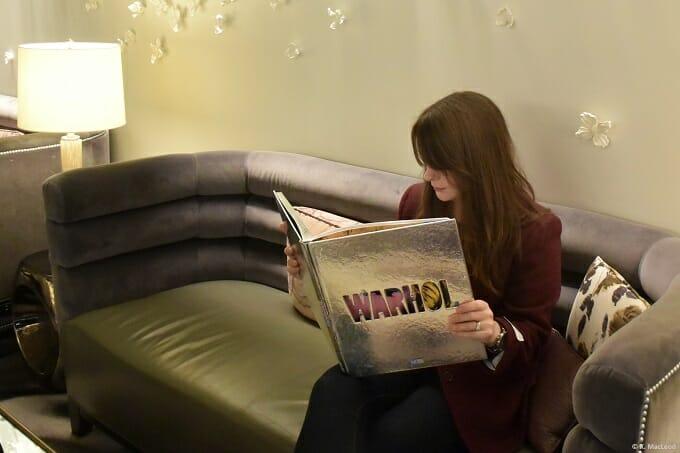 Reading in the lobby of Loews Regency New York