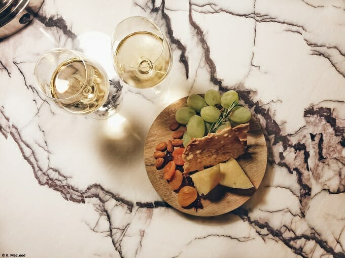 Wine and cheese on a marble table at Loews Regency New York