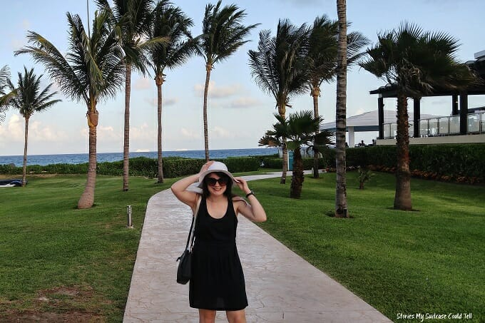 Standing in front of palm trees at Now Jade Resort