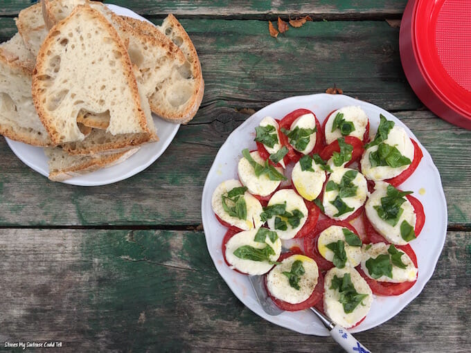 Caprese salad on green wooden table