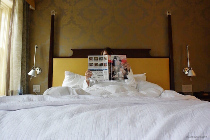 Reading in hotel bed
