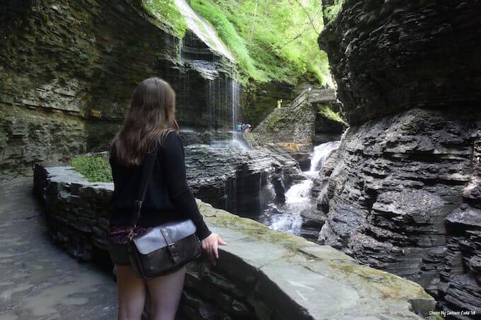 Woman looking at waterfalls Watkins Glen State Park