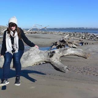 Sitting on a log at Driftwood Beach