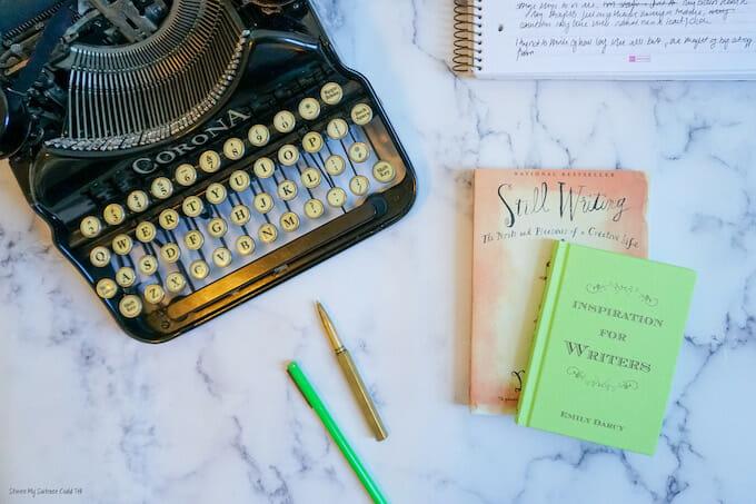 Typewriter and books